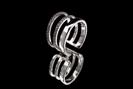 White gold ring with precious stones