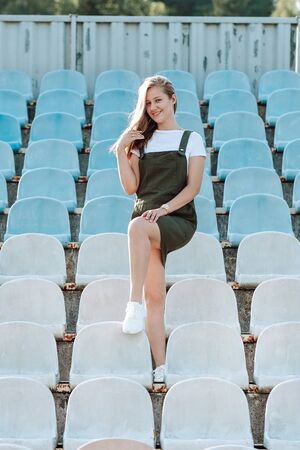 Girl smiles at the camera while standing in the stadium Stock fotó