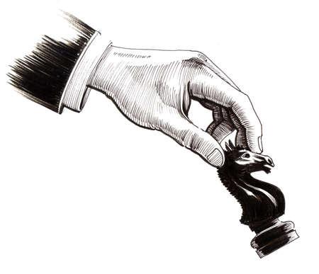 Hand met een schaakstuk