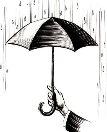 Hand with umbrella in the rain