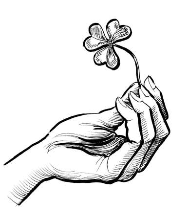 Hand with clover 스톡 콘텐츠