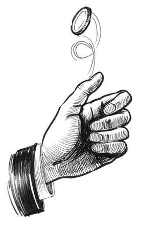 コインを反転する手 写真素材