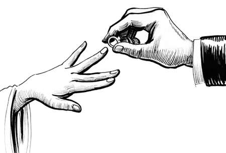 Male hand putting wedding ring on a female hand 스톡 콘텐츠