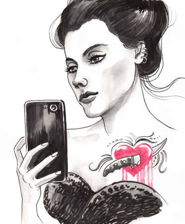 Pretty woman with a tattoo taking a selfie. Stok Fotoğraf