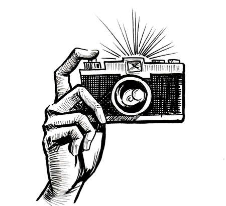 Hand holding retro camera. Ink black and white drawing
