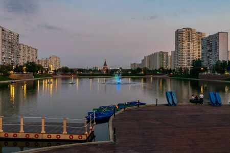 Boat station at Brateevo pond in twilight, Moscow, Russia. Blue hour.