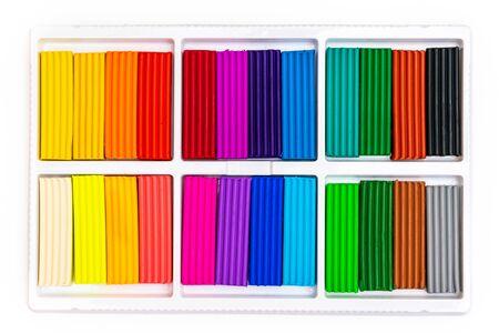 Set of 24 colorful plasticine bricks isolated on white Фото со стока