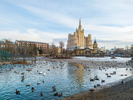 MOSCOW, RUSSIA - FEBRUARY 20, 2020: View of The main entrance of The Moscow Zoo and Kudrinskaya Square Building from the large pond.