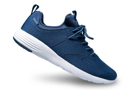 New dark blue sneakers isolated on white background. Фото со стока