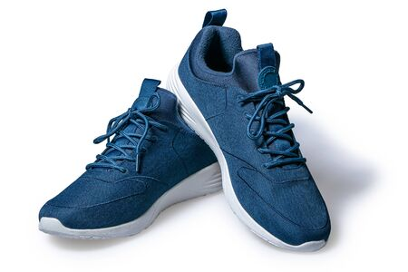 Pair of new dark blue sneakers isolated on white background.