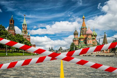 Barrier tape against Kremlin, St. Basil Cathedral in Moscow
