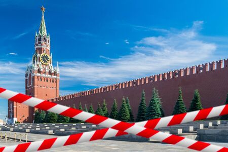 Barrier tape against Kremlin and Spasskaya tower at Red Square in Moscow, Russia Фото со стока