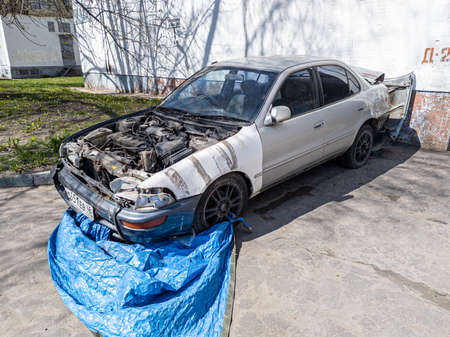 MOSCOW, RUSSIA - MAY 2, 2020: Old damaged abandoned car