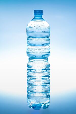 1.5 liter plastic bottle of fresh water isolated on blue-white background