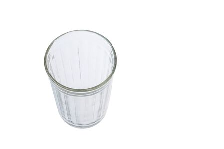 Empty faceted glass isolated on a white background