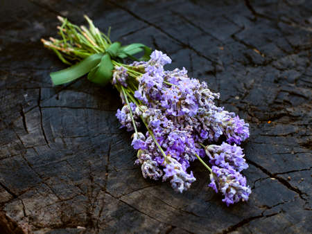 bonded: Fresh lavender flowers on the wooden stock bonded with the stylish hempen cord