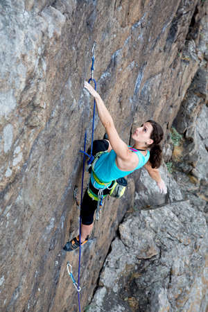 crack climbing: Female rock climber hanging over the abyss top view Stock Photo