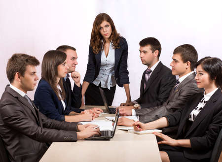 severe: Dissatisfied manager Severe female manager criticises her team of subordinates