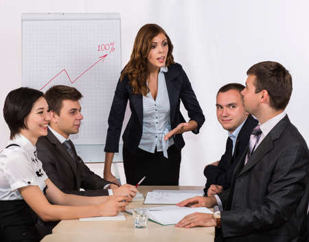dissatisfied: Dissatisfied manager Severe female manager criticises her team of subordinates