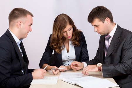 dress code: Business people discuss deal negotationing dicsussion offer paperwork smart casual dress code desk Stock Photo