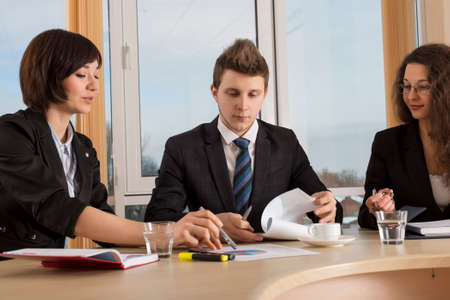 executive assistants: Corporate life Annoyed and tired young male executive surrounded with two nice female assistants