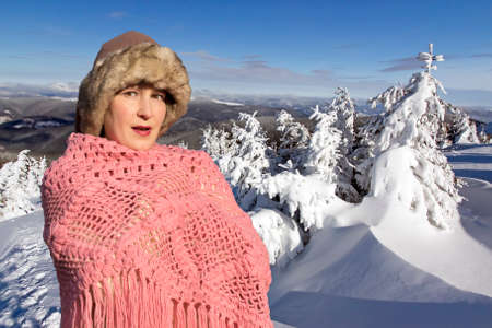 snowbound: Snowbound dreaming Dreaming lady dressed in warm handmade winter hat, sweater and scarf, in the snowbound landscape