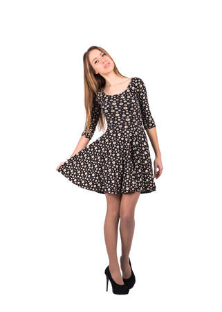 expressing joy: Full body portrait of young lady in casual dress, expressing joy and happiness, on white background