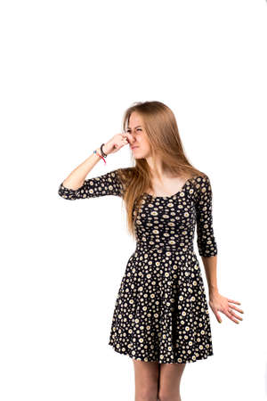 Smell bad Young lady makes disgusts the smell Stock Photo