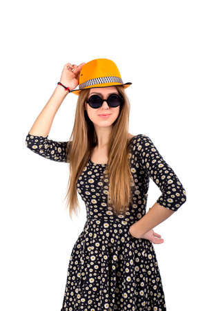 ardor: Stylish lady in orange hat Young Caucasian female in stylish hat and sunglasses expresses ardor and energy