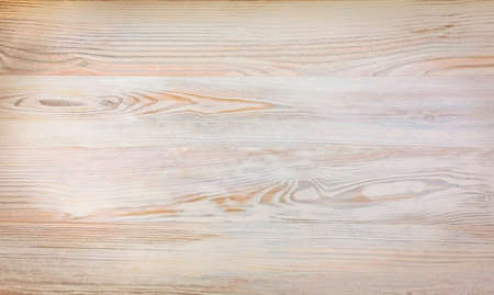 Wood plank warm brown texture background Close up image of raw wooden texture birch oak warm colours some corner vignetting copy space centre of field Stockfoto