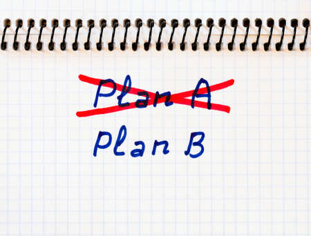 failed strategy: Plan A failed we need plan B Handwritten phrase PLAN A crossed out with red pencil PLAN B phrase written below Stock Photo