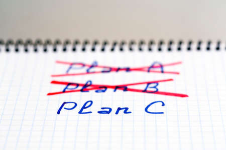failed plan: Plans A and B failed we need plan C Handwritten phrases PLAN A and B crossed out with red pencil  PLAN C phrase written below Stock Photo