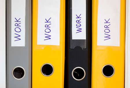 new business problems: Hardworking environment Several office folders in row with word WORK written on each