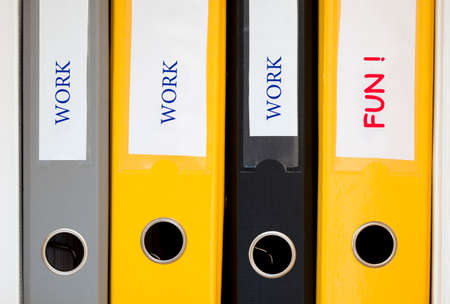 work life balance: Work and life balance Conceptual image describing the correct business and private life balance. Three office folders in row with word WORK and FUN written on latter
