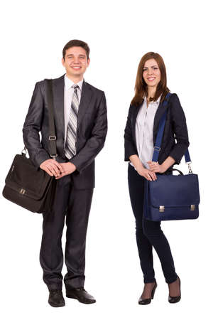 Nice young couple Young male and female students with bags officially dressed on white background
