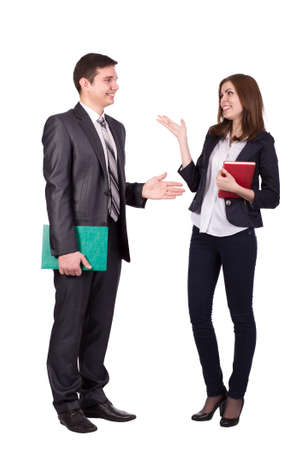 dresscode: Emotional conversation Young male and female, officially dressed, discussing and hand gesturing