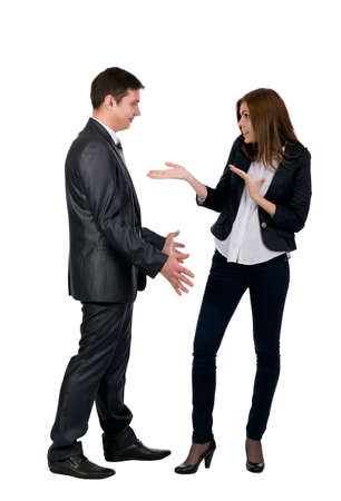Conflict Young male and female emotionally discussing, making wide gestures. Both are dressed business style, white background Stock Photo