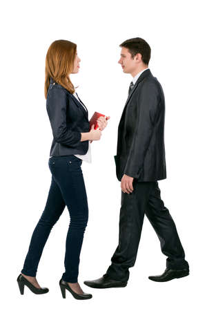 dress code: Officially dressed male and female walking towards each other Young man and woman in business style dress code treading. Full body, on white background Stock Photo