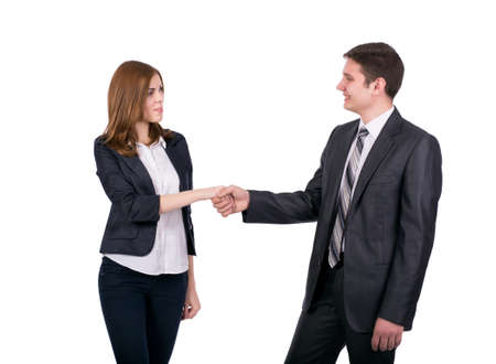 dress code: Introduction of male and female business people Young man and woman shaking hands. Business style dress code, white background