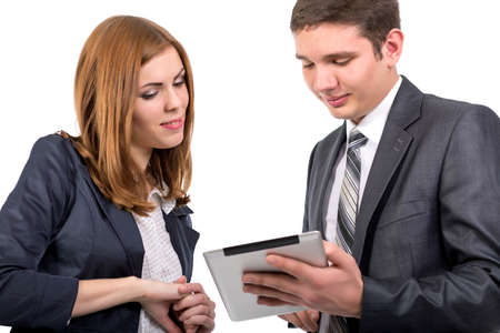 devise: Male consultant explains features of electronic devise to female customer Portrait of young man and woman keeping tablet PC touching screen discussing its features