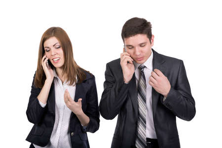 dress code: Telecommunications Business People Man and Woman Two People Talking on Phone Office Dress code Stock Photo