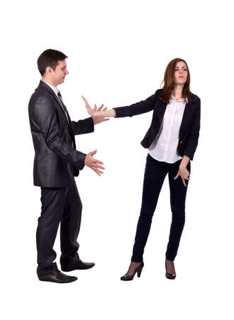 Stop sexual harassment Image of two young adult people. Man attempts to harass lady, she expresses strong rejection gestures. Official dress code, white background, full body Stock Photo