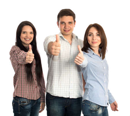 polygamy: Young man and two beautiful girls makes OK hand sign casual checkered shirts blue jeans lifestyle on white background focus on faces hands slightly blurred