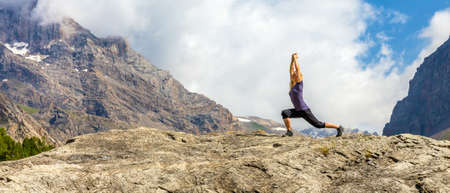 mountains and sky: Young woman doing morning fitness outdoor in mountain landscape