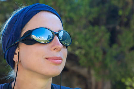 bandana girl: Portrait of Smiling Girl Sporty Head Bandana Sunglasses Reflection of Mountain Landscape