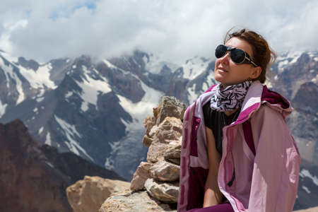 outwear: Portrait of Smiling Woman Sporty Style Clothing Outwear Sunglasses Sunny Mountain Landscape