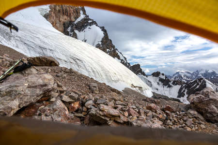 vanishing point: Landscape from Camping Tent Vanishing Point Steep Glacier Tongue  Ice and Rock Cliff Terrain Alpine Gear Stock Photo
