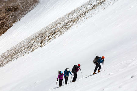 hardly: Members of Alpine Expedition Hardly Walking Up on Steep Snowfield Using Ice Climbing and Hiking Gear