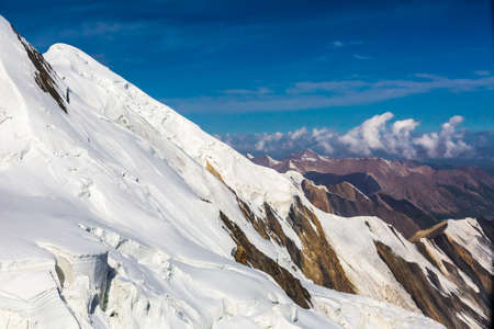 ridges: Aerial View of High Altitude Snowbound Mountains with Massive Glaciers Sharp Rock Ridges and Ice Slopes
