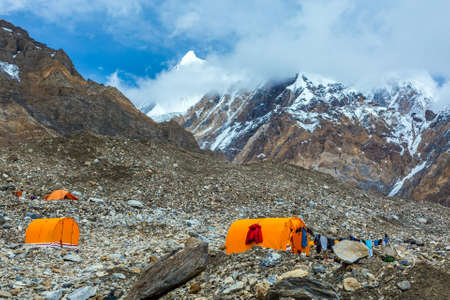 Mountain Expedition Camp Located on Giant Glacier Moraine Clothing Hanged on Tent for Drying after Rain